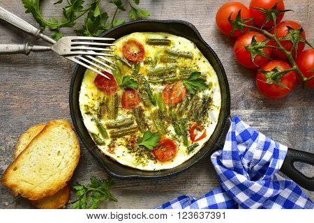 Omelet With Tomatoes And Asparagus Bean.