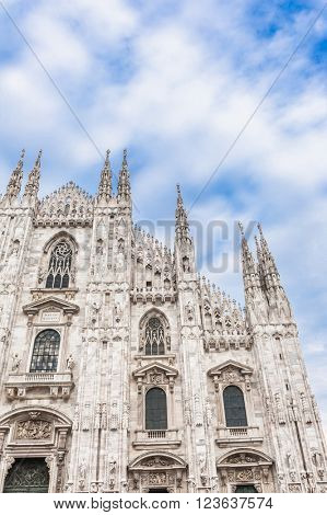 Famous Milan Cathedral is the fifth largest cathedral in the world. Detail of the front against the sky Milan, Italy