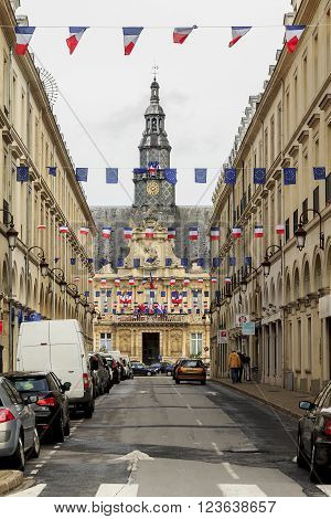 Reims, France - May 15: This is a street going to the square with the Town Hall May 15, 2013 Reims, France.