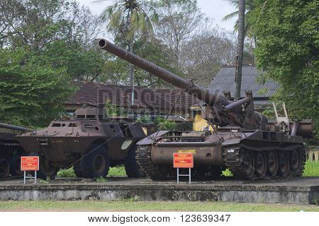 HUE, VIETNAM - JANUARY 08, 2016: An armored personnel carrier and 175 mm self-propelled artillery installation in the city of Hue