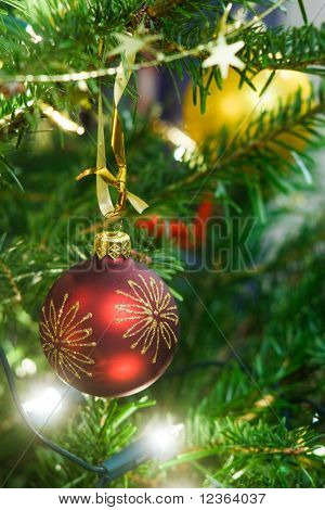 Christmas ball and garland on the fir tree