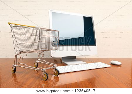 Shopping cart  and computer on hardwood table