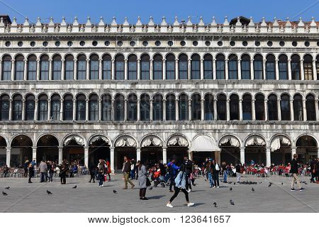 Venice, Italy - March 20, 2016 : Locals and tourist at Piazza San Marco, the principal public square of Venice, Italy,