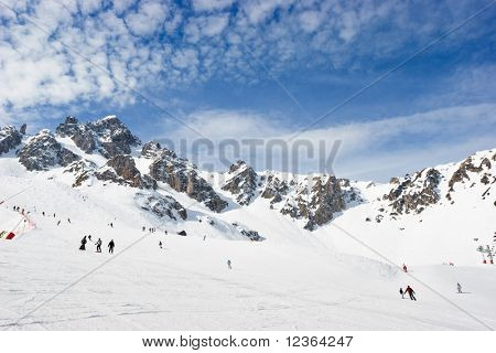 Skiers on a piste at Courchevel ski resort, French Alps