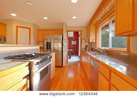 Golden Kitchen With Red Wall