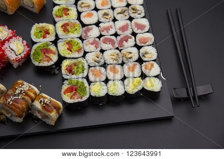Sushi Set On A Black Plate Over Dark Background