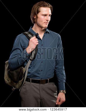 Man with backpack.  Studio shot over black.