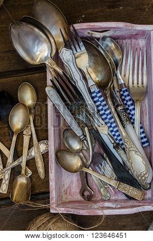 Old fork and spoon on wooden background