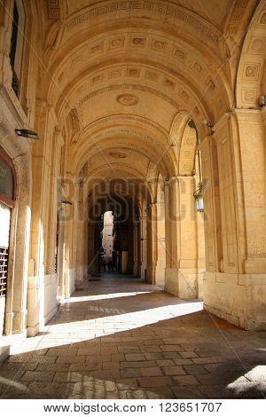 Arcades on the streets of La Valetta, Malta
