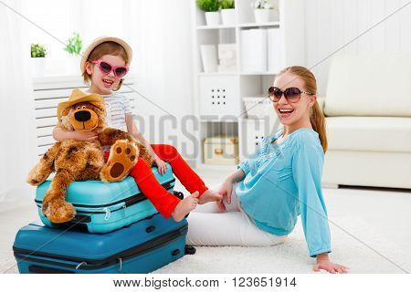 happy family tourist mother and child daughter suitcases packed for vacation ** Note: Shallow depth of field