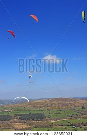 Paragliders flying high above Dartmoor in Devon