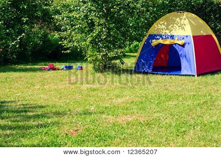 Empty children playground with colorful tent at sunny day