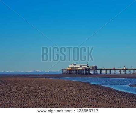 The tide and beach at North pier Blackpool UK.