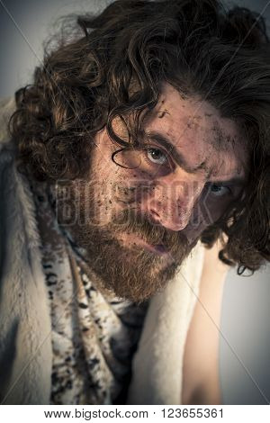 Silly realistic caveman with dirty face in portrait
