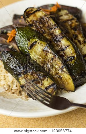 Grilled zucchini and portobello mushrooms in balsamic vinegar glaze with long grain rice