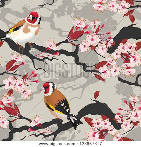 Branch of blooming cherry with goldfinch vector seamless background