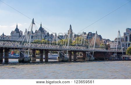 LONDON, UK - SEPTEMBER 10, 2015: City of London view from the river Thames and Waterloo bridge in summer day