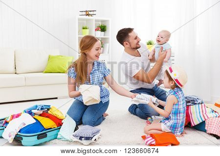 happy family mother father and two children packed suitcases for the trip holiday travel vacation