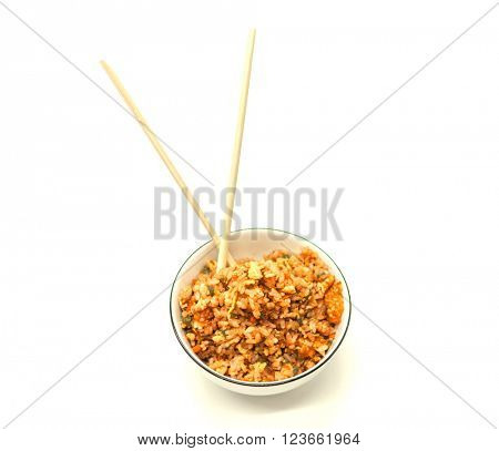 Fried Chinese rice with vegetables and egg, in a bowl on a white background with chopsticks. Chinese favourite garnish