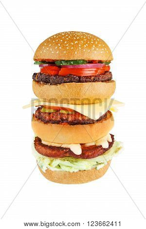 Classic american burger food, big double hamburger, cheeseburger with chicken, beef meat, tomato, cucumber, onion, fresh bun, closeup isolated at white - fast food takeaway menu, overeating concept