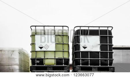 Black and green chemical container in a storage area