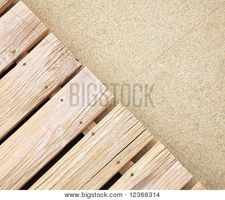 Weathered wooden boardwalk on  sand