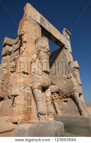 Two giant Lamassus giarding the Gate of All Nations in the ruins of ancient Persepolis capital of Achaemenid Empire in Shiraz Iran.