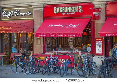 LONDON, UK - SEPTEMBER 10, 2015: Cafe at the Trafalgar street with parked bikes on the side
