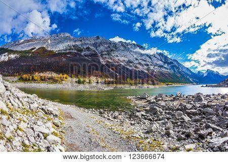Stony shore of Medicine Lake in the fall shoaled. Jasper National Park, Canada