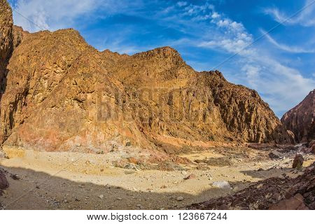 Israeli winter. Picturesque and multi-color Black canyon in ancient Eilat mountains