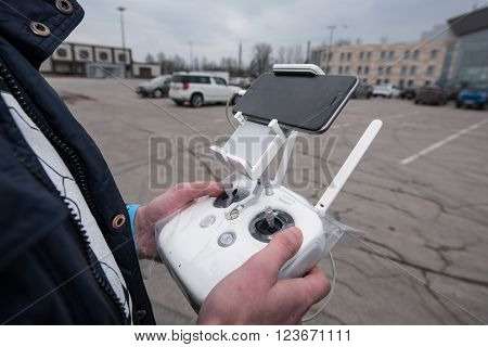 Saint-Petersburg, Russia - March 26, 2016: People learn to control unmanned aerial vehicles - drones with the help of experienced users Phantom Series device