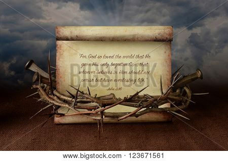 John 3:16 scroll surrounded by crown of thorns and nails