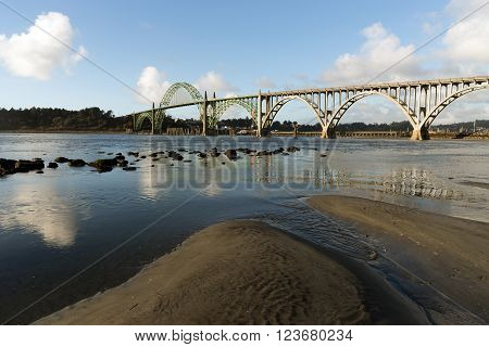 The river meets the Pacific Ocean under the Newport Bridge
