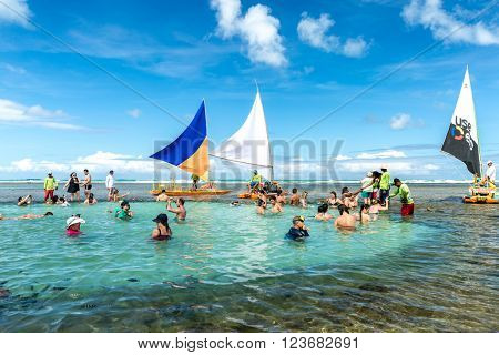 RECIFE, BRAZIL - CIRCA MARCH 2016 - Tourists enjoying a beautiful day in Porto de Galinhas, Brazil.
