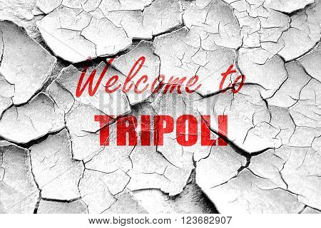 Grunge cracked Welcome to tripoli with some smooth lines