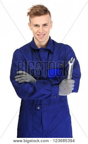 A young repairman with crossed arms holding wrenches, on white background