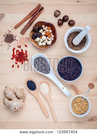 Body care and super health food selection with supplement powders in bowls and spoons setup on wooden background.