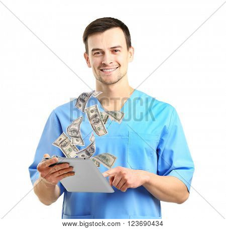 Financial concept. Make money on the Internet. Doctor with tablet isolated on white
