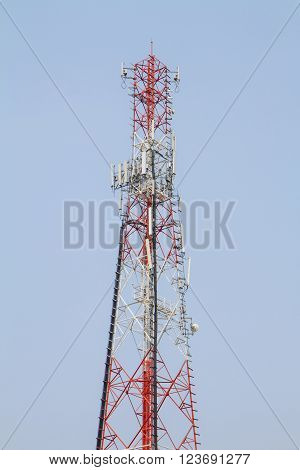 mobile phone pole on blue sky background