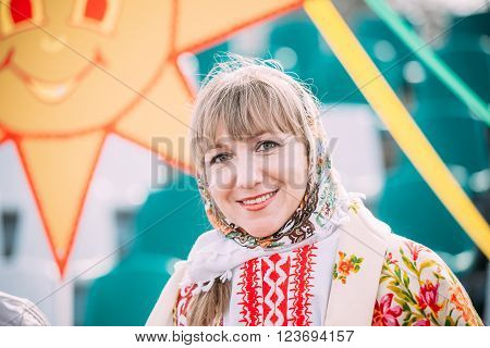 Gomel, Belarus - March 12, 2016: Close up of unknown beautiful young adult woman in national folk clothes at Celebration of Maslenitsa Shrovetide holiday