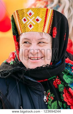 Gomel, Belarus - March 12, 2016: Close up of unknown beautiful aged woman in national folk clothes at Celebration of Maslenitsa Shrovetide holiday