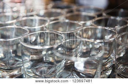 glassware, dishware and alcohol concept - close up of empty clean whiskey glasses set at restaurant or bar
