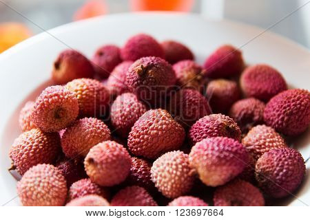 food, fruits and eating concept - lychee on plate