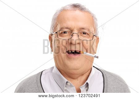 Portrait of a toothless senior smoking a cigarette and looking at the camera isolated on white background
