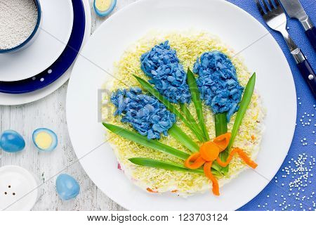Original salad on holiday table in the form of bouquet first spring flowers hyacinth. Beautiful and colorful dish for Easter festive meal top view