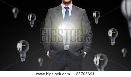 business, inspiration, startup, idea and people concept - close up of businessman in suit with ligh bulb icons