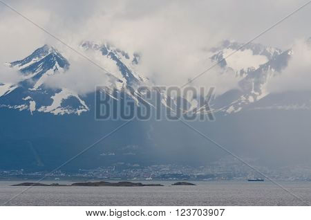 Ushuaia in the fog. Ushuaia the most southerly city in the world. It is the capital of the Argentine province of Tierra del Fuego and is the departure place for Antarctic Cruise ships province of Tierra del Fuego.