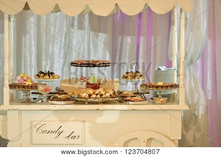 Candy bar with many cakes in natural ligth