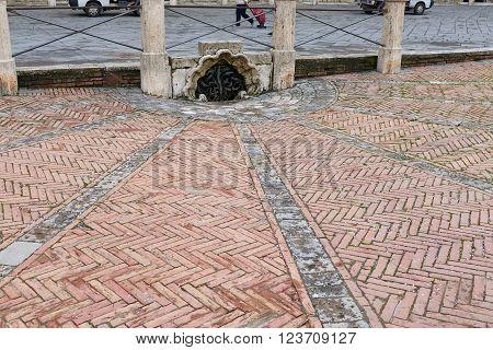 rain drainage hole at piazza del Campo in Siena Tuscany Italy.
