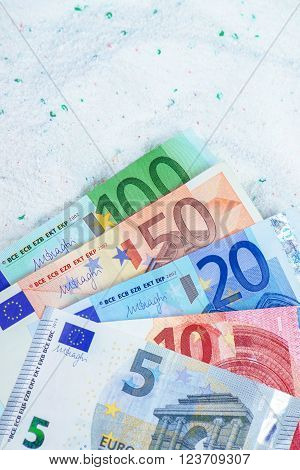 Saving money on quality cost-effective washing powder euro banknotes in laundry detergent.